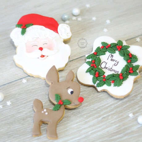 Beautiful-father-christmas-biscuit-and-reindeer-and-holly-cookie 1